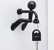 pared hombre escalada estilo de diseño creativo titular llave magnética